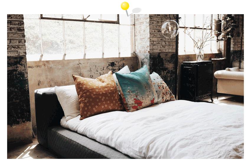 Raumbild Loft mit großem Bett